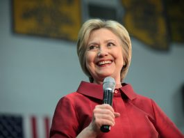 Hillary Clinton speaking with microphone in Arizona