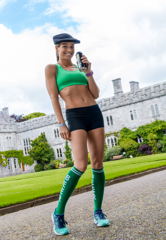 Corky with a can of Murphy's and her beer socks, at University College Cork